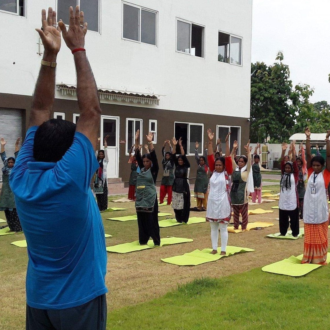 Indian Factory workers practising Yoga