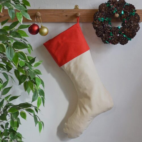 Christmas stocking hung up with wreath