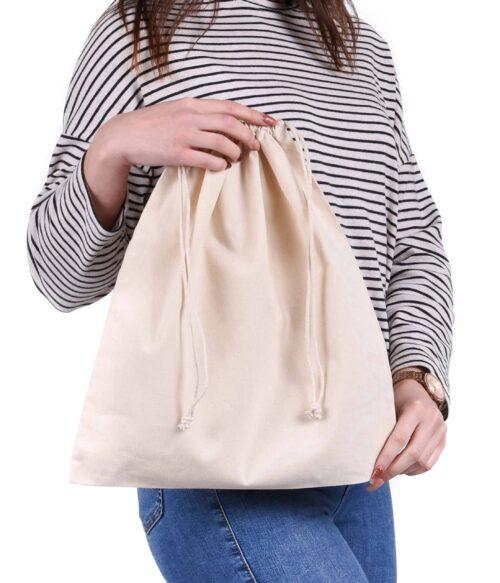 A woman holiday a white blank unprinted drawstring bag